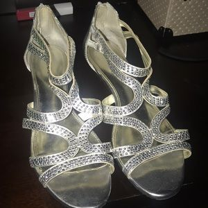 Silver sandals with diamonds on it